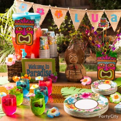 a tropical table decorating idea that invites guests to get their luau on