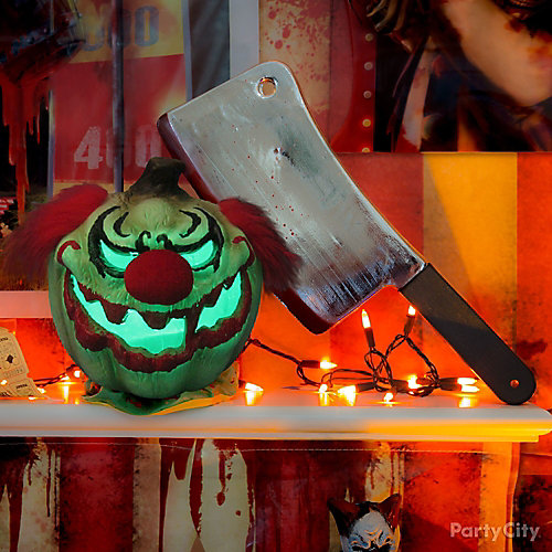 Halloween Cleaver and Clown Head Mantel Idea